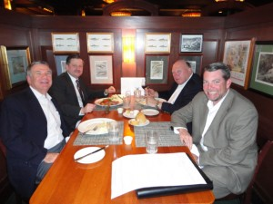Deane Foote, Dale Benish, Saul Grohs, and Paige Webster (pictured clockwise from bottom left) enjoy dinner at McCormick & Schmick's in Phoenix.